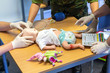 Medical exercise with equipment on a child puppet