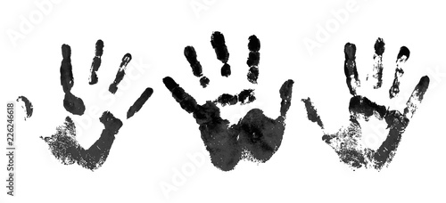 Fototapeta Hand in the black blood. Bloody handprint on white background