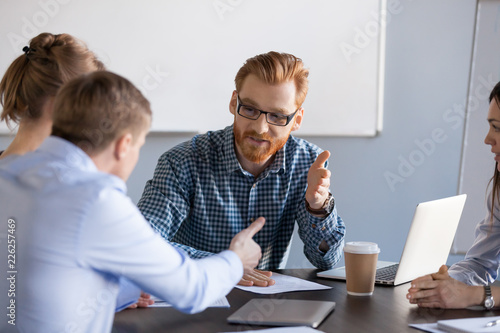 Canvas Print Serious business men negotiating having discussion, dispute or disagreement at m