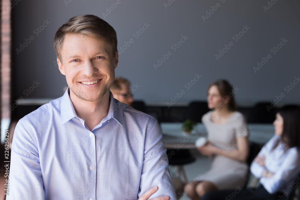 Fototapeta Middle aged smiling company ceo, happy team leader or successful business man looking at camera posing in office, happy professional manager, confident coach or friendly male boss headshot portrait
