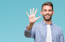 Young Handsome Man Wearing White T-shirt Over Isolated Background Showing And Pointing Up With Fingers Number Five While Smiling Confident And Happy.