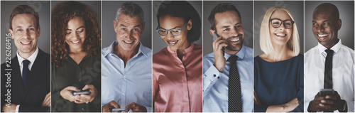 Photo  Diverse group of smiling businesspeople using cellphones