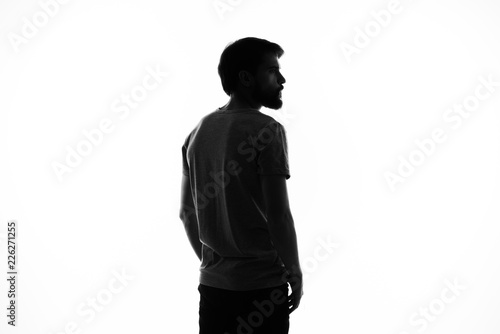 dark silhouette of a young man on a light background Fototapet
