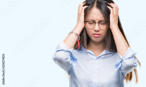 8996b09827b Young asian business woman wearing glasses over isolated background  suffering from headache desperate and stressed because