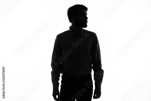 Fotografie, Tablou silhouette of a man on a light background