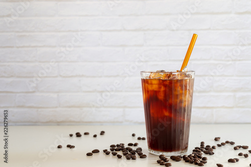a glass of homemade cold cold brew coffee on white table Fototapet