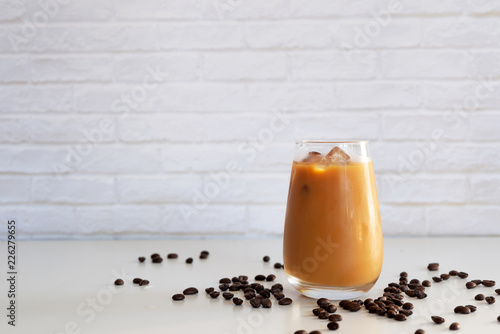 Cuadros en Lienzo a glass of homemade cold cold brew coffee with milk on white table