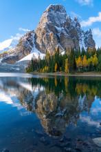 Sunburst Peak Reflects Perfectly Into Sunburst Lake Full Of Fall Colors