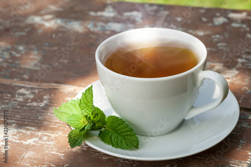 Staande foto Thee A Cup of tea on a wooden table.