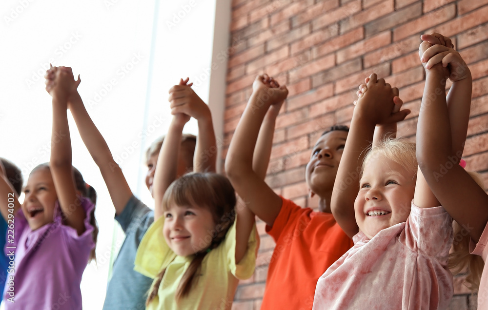 Fototapety, obrazy: Little children holding hands together indoors. Unity concept