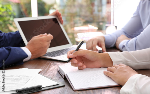 Lawyer working with clients at table in office, focus on hands Canvas Print