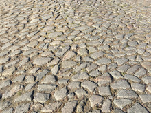 Rough Surface Of An Old Cobblestone Road