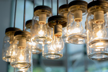 The Chandelier Is An Interesting Decor Of Glass Jars And Bottles