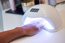 Manicured Nails In UV Lamp In ...