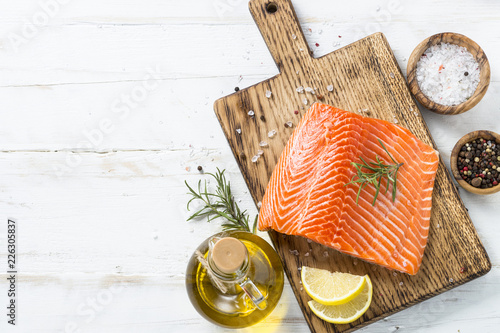 Canvas Print Salmon fillet with  spices on white.