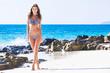 Happy girl in bikini at seaside
