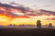 beautiful, dramatic sky over an autumn field enveloped in the morning mists-Poland, Drawskie Lakeland