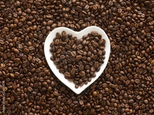 Coffee beans in heart shape bowl