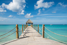 Beautiful Gazebo In Caribbean Sea With Tuquoise Water And Blue Sky