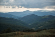 Beautiful landscape of Carpathian mountains with green vegetation and overcast sky