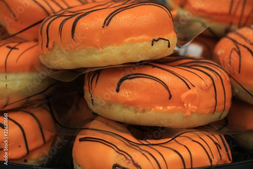 Orange iced donuts