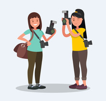 Two Female Photographer With C...