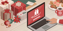 Santa Sending Gifts Using His Laptop