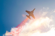 Fighter Jet Planes Fly And Leave Behind A Smoke Trail, Clouds Sun Glare.