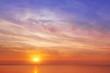 Leinwandbild Motiv Beautiful, orange-pink sunset over the sea. Background image.