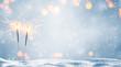 canvas print picture - zwei brennende wunderkerzen im schnee