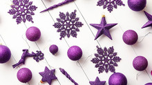 Christmas Purple Collection, Balls And Decorative Ornaments, On White Wooden Background.