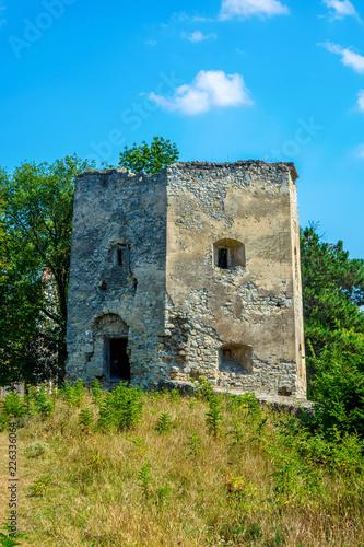 Foto op Plexiglas Kasteel Photo of ancient stone castle tower in Krivche