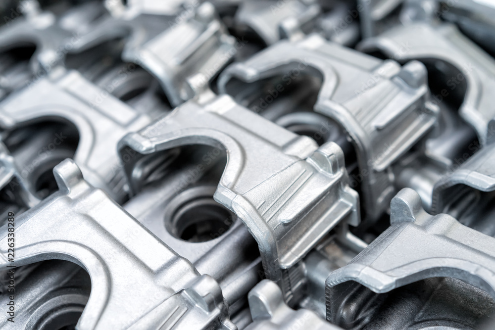 Fototapety, obrazy: Pile of aluminum automotive parts head cylinder, casting process in the automotive factory