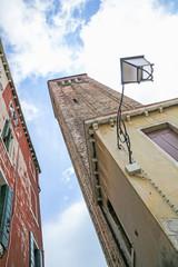 Fototapeta na wymiar A streetlight lamp on a historic building in Venice, Italy, Europe.