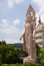 Angel Statue At Wat Phra Thad Pha Son Kaew Petchabun ,Thailand  With The Background Has A White Cloud And Blue Sky.