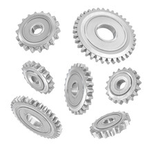 3d Rendering Of Several Metal Spur Gears Hanging In Different Angles On A White Background.