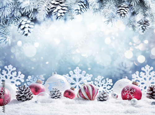 Obraz Christmas Card - Baubles On Snow With Snowy Fir Branches