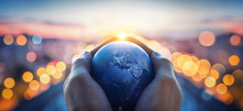 The Globe Earth In The Hands O...