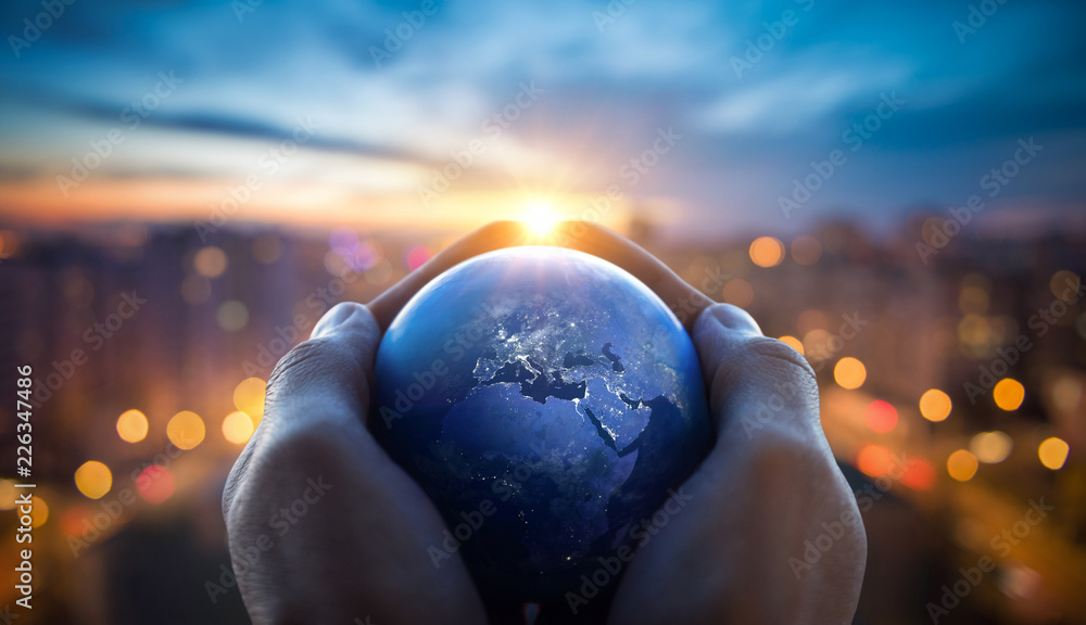 Fototapety, obrazy: The globe Earth in the hands of man against the night city. Concept on business, politics, ecology and media. Earth day abstract background. Elements of this image furnished by NASA.
