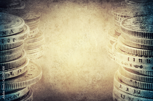 Photo  Finance concept. Old silver coins on vintage background.