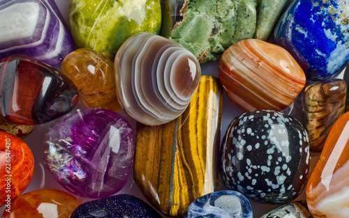 Beautiful coloured semi precious gemstones background.