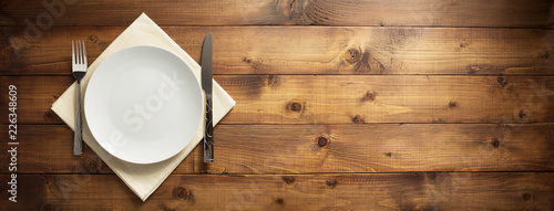 plate, knife and fork on napkin cloth - 226348609