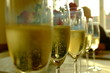A close-up of the champagne glasses with champagne