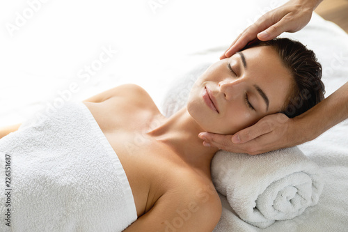 Young and beautiful woman during facial massage session
