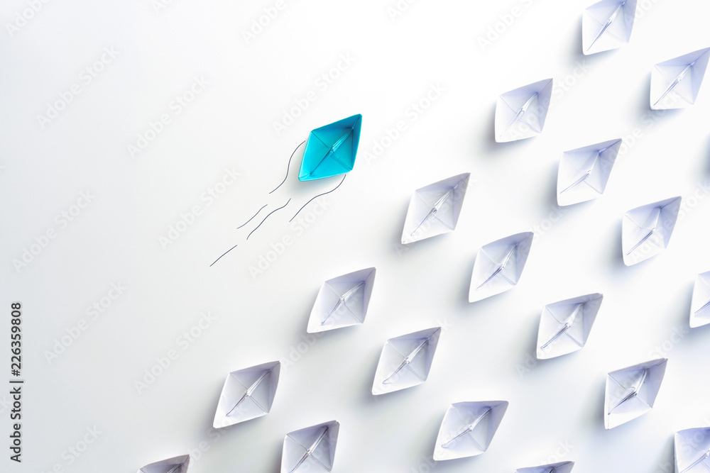 Fototapety, obrazy: Blue paper ship are different from others and group of paper ships in one direction. Business for Innovative, solution concepts.