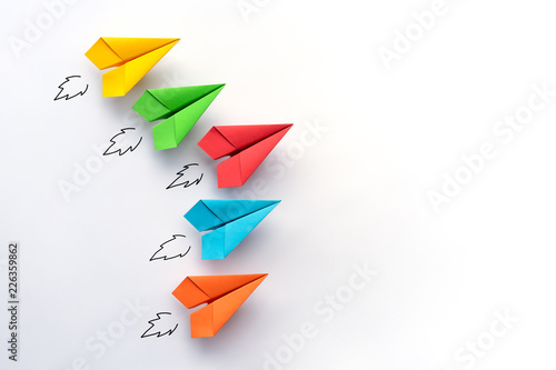 Photo Paper plane on white background. Business competition concept.