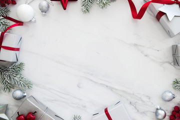 Christmas and New Year holiday background. Xmas greeting card. Christmas gifts on white marble background top view. Flat lay