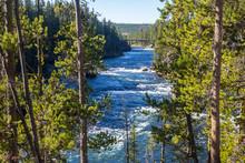 Yellowstone River Flowing Under A Bridge