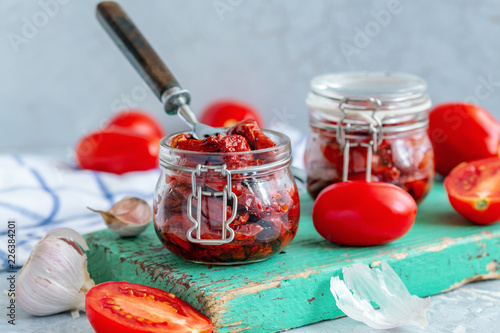 Jars with organic sun-dried tomatoes.