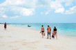 Thick and slender women stroll along the beach with local guide Zanzibar